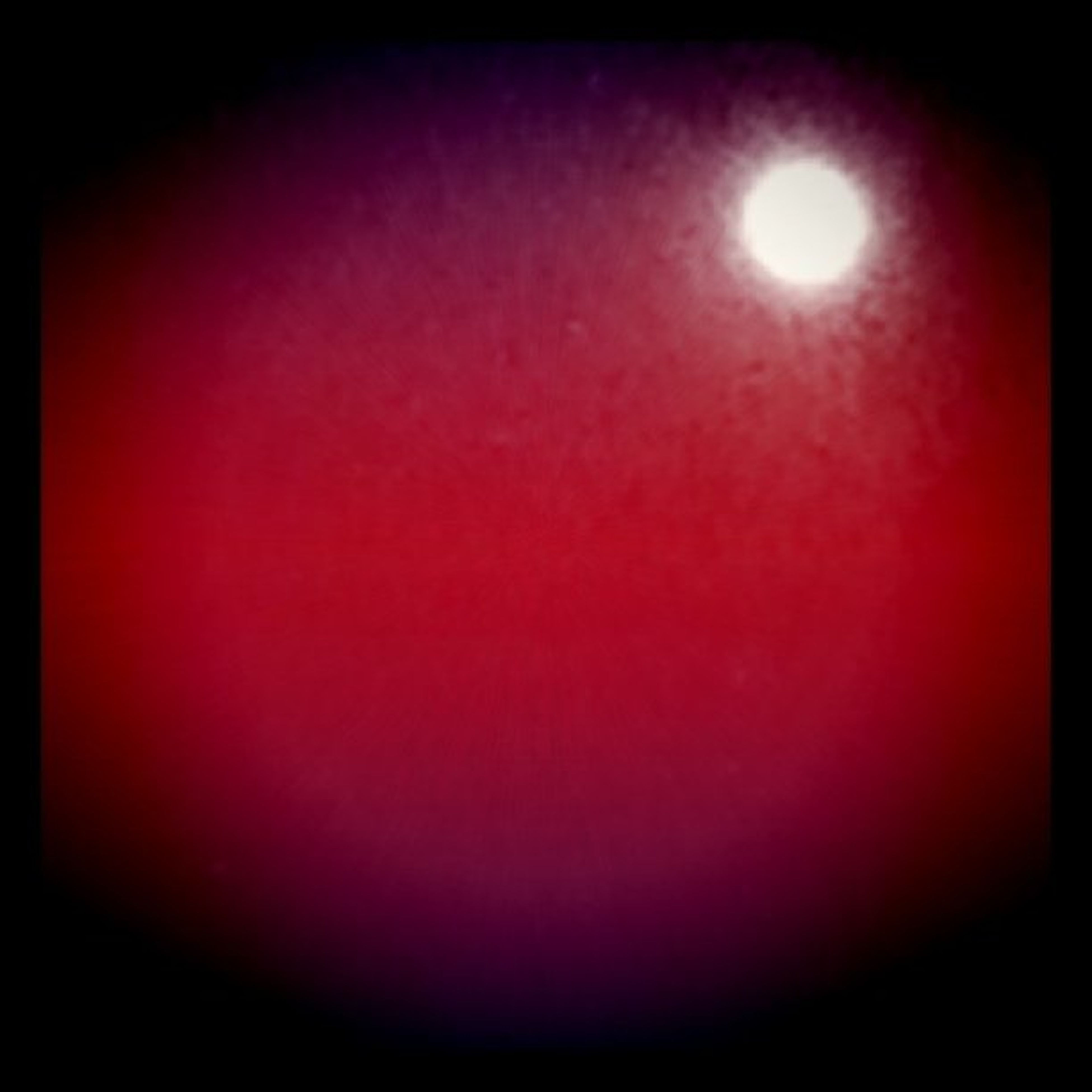 red, copy space, night, sun, dark, moon, low angle view, auto post production filter, illuminated, vignette, transfer print, glowing, no people, light - natural phenomenon, nature, beauty in nature, lighting equipment, lens flare, outdoors, tranquility