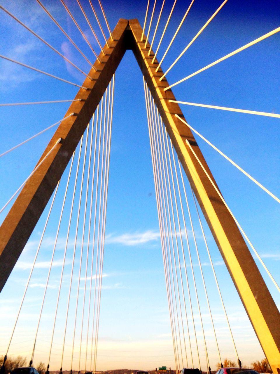 bridge - man made structure, suspension bridge, connection, engineering, built structure, architecture, low angle view, transportation, sky, no people, blue, day, outdoors, bridge, travel, travel destinations, line, chain bridge
