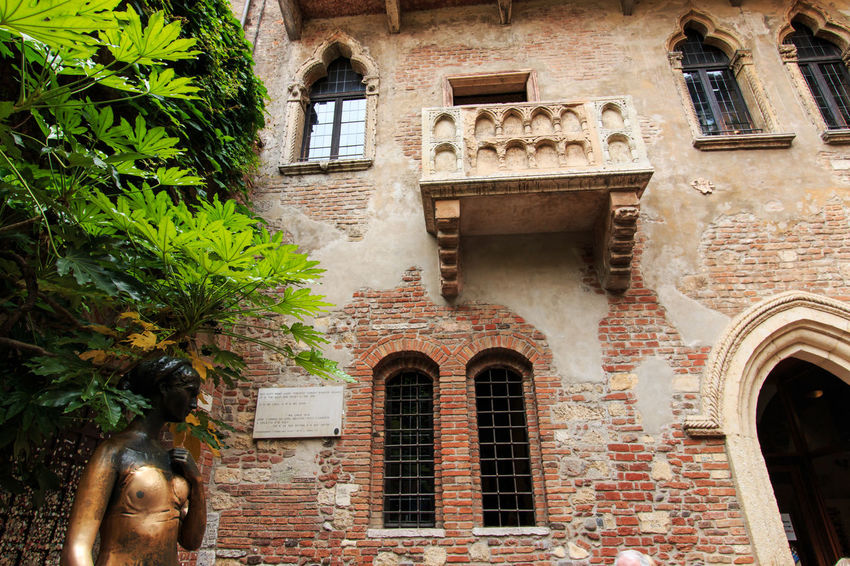 Juliet's balcony - Verona - Italy Arch Architecture Arena Building Building Exterior Built Structure City City Life Coluseum Creeper Day Façade Italy Low Angle View Outdoors Romeo And Juliet Verona Window