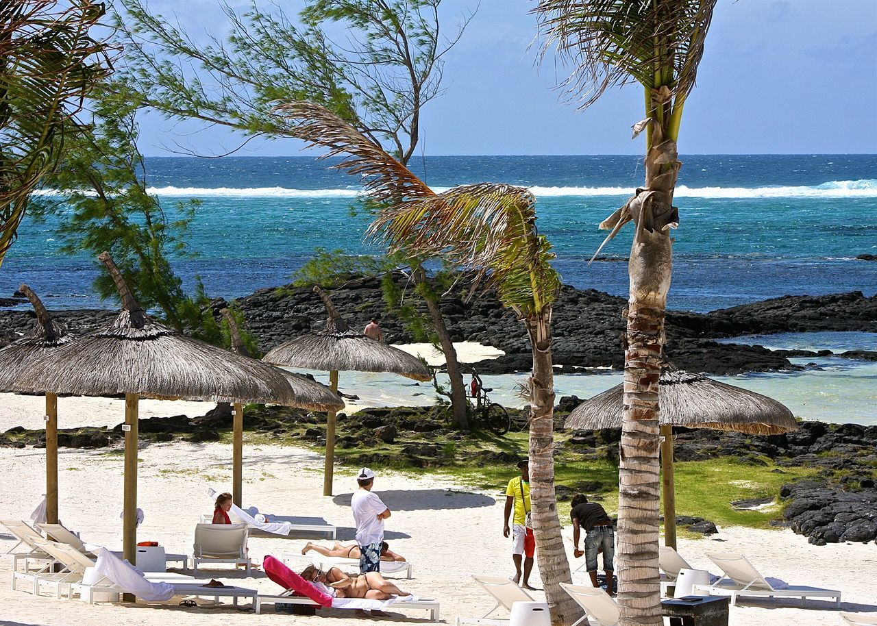 Beach Beach Life Beauty In Nature Blue Calm Full Length Horizon Horizon Over Water A Bird's Eye View Mauritius Medium Group Of People Ocean On The Beach Parasol Relaxation Rock Sand Scenics Sea Shore Sky Sunbathing Sunshade Water Wave