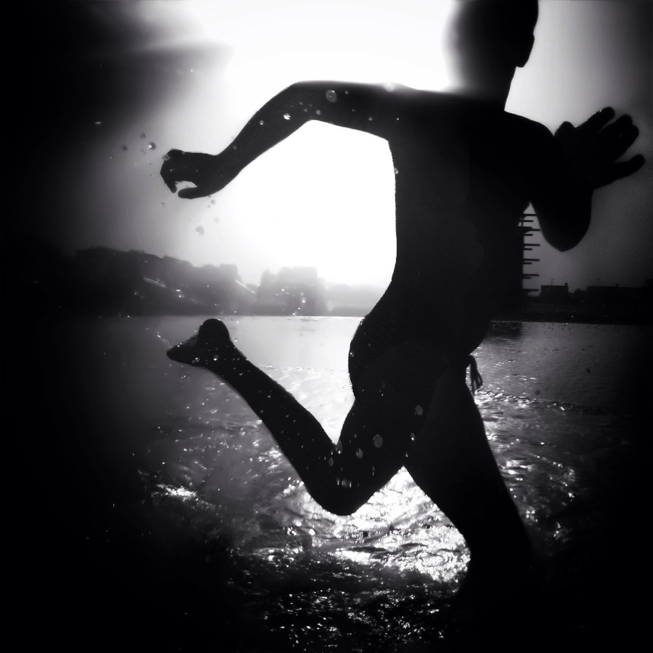 Silhouette Person Running At Lake