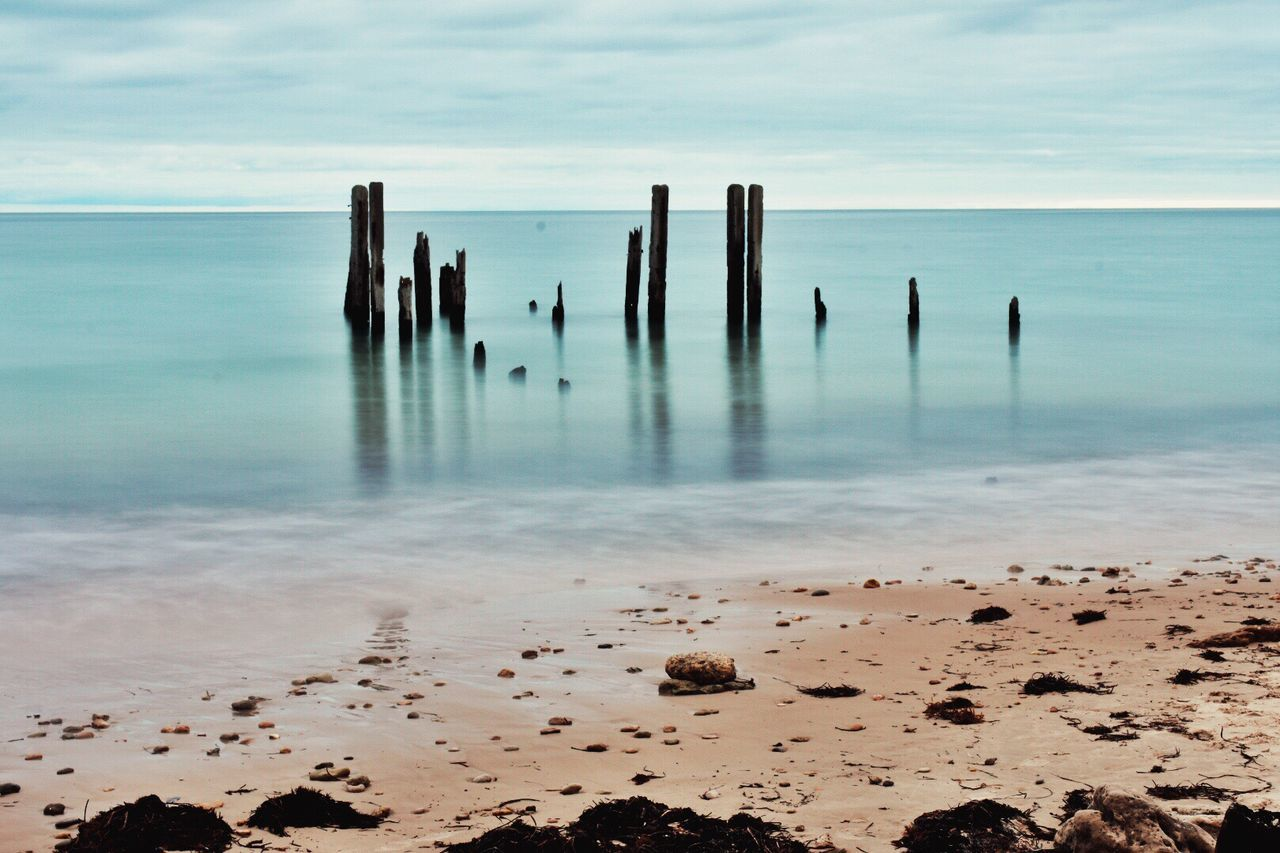 Water Sea Horizon Over Water Beach Nature Sky Beauty In Nature Scenics No People Wooden Post Tranquility Day Outdoors Sand