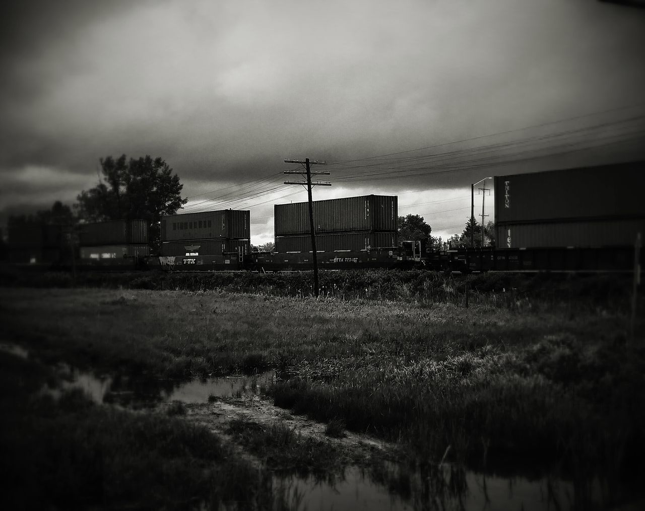 transportation, sky, no people, freight transportation, field, outdoors, built structure, day, architecture, factory, grass, tree, nature
