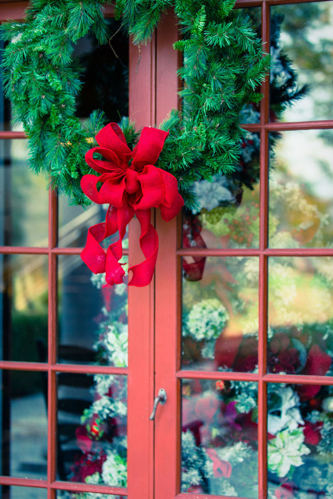 Christmas Christmas Decorations Daylight Decor Decoration Door French Door Glass Glass - Material Green Hanging Home Exterior Multi Colored Natural Light No People Pattern Red Reflection Ribbon Shape Transparent Window Window Sill Wreath