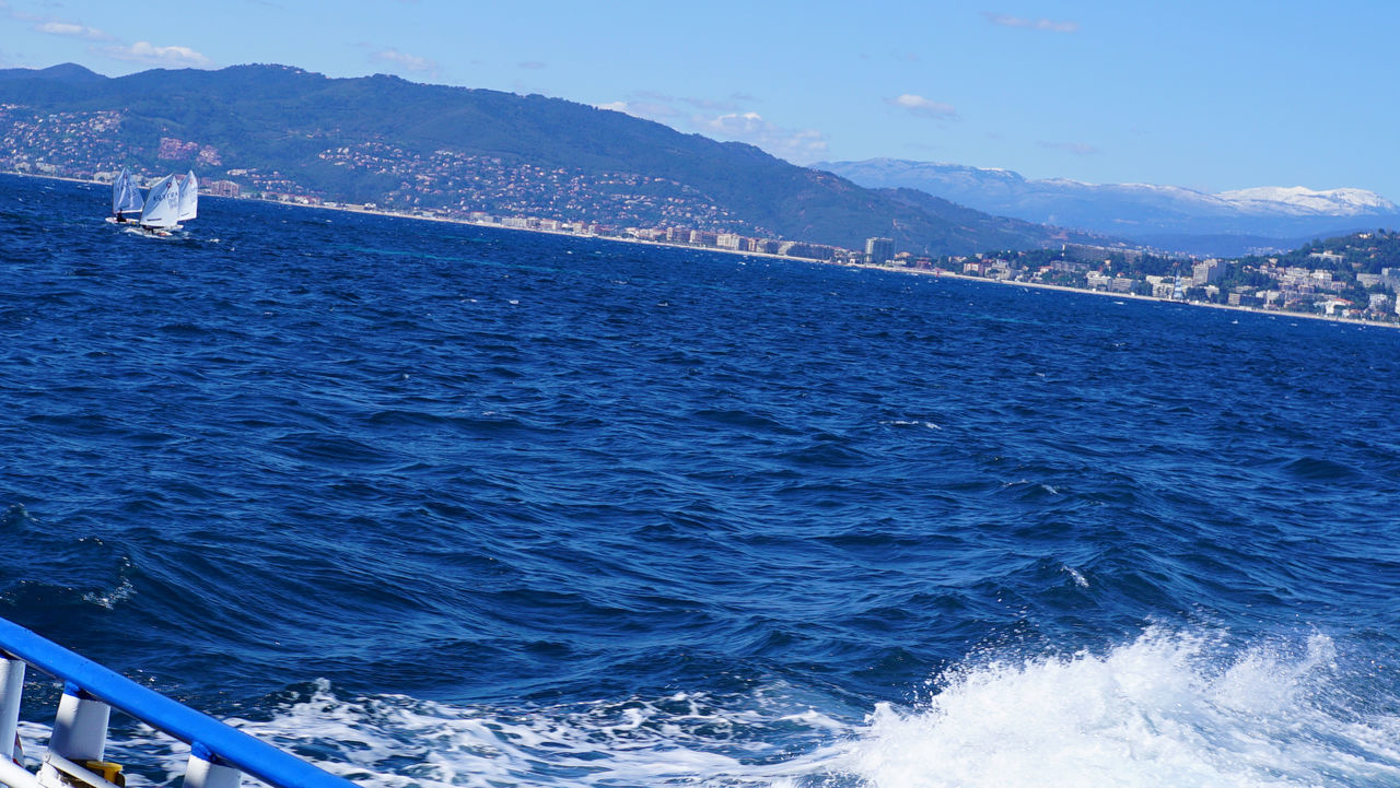 Small boats catching the breeze in Cannes Beauty In Nature Blue Blue Sky Holiday Landscape Mountain Ocean Ocean View Outa Outdoor Photography Outdoors Regatta Sailboat Sailing Sailing Ship Sea Sea And Sky Seascape Sky Travel Travel Destinations Water Waves Yacht Yachting