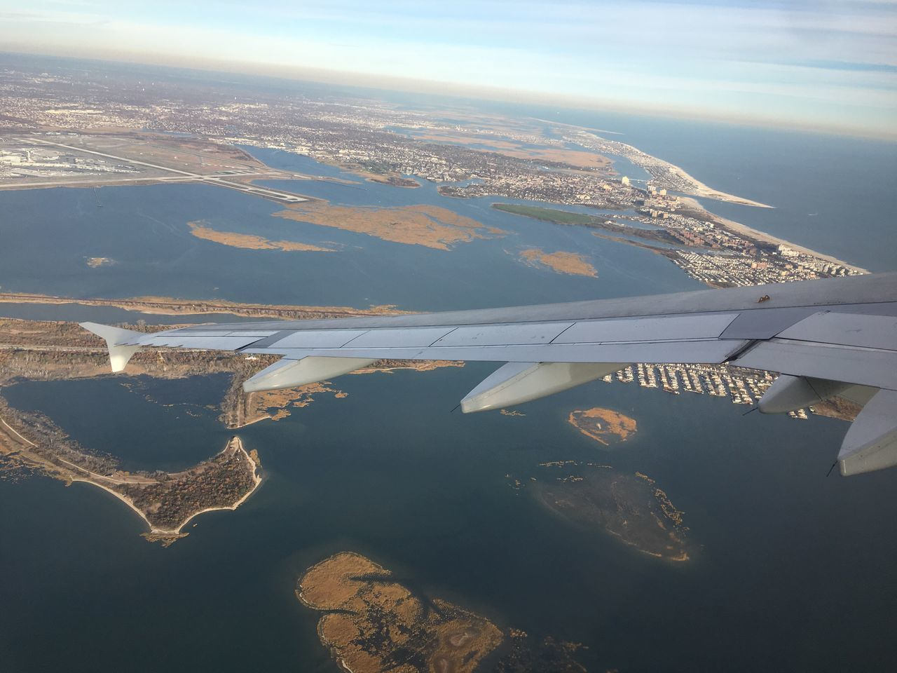JFK Airport Water Aerial View Built Structure Nature Transportation Mode Of Transport No People Sky Landscape Day Scenics Architecture Beauty In Nature Airplane Outdoors Sea Cityscape Air Vehicle Airplane Wing Jamaica Bay