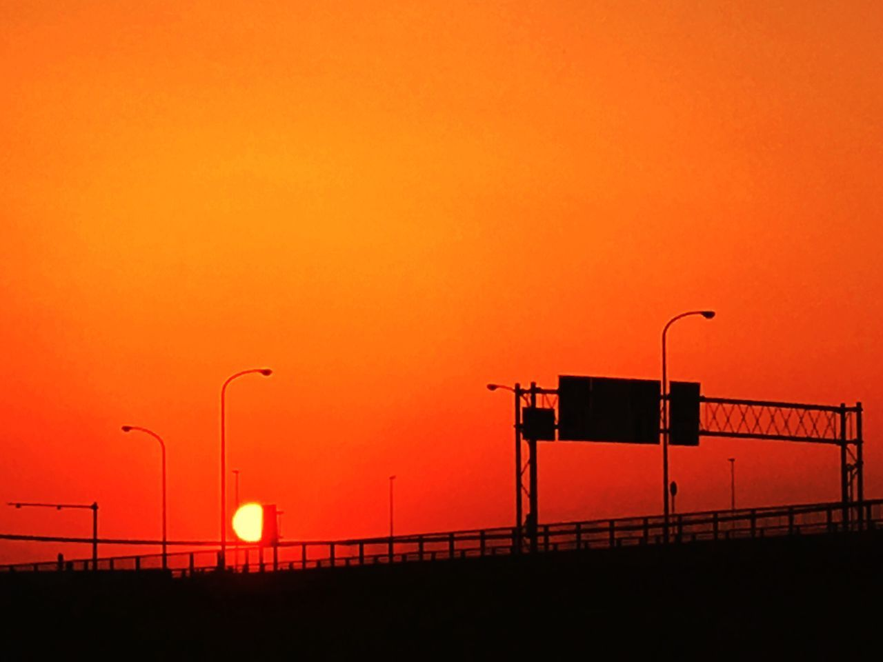 Sunset Orange Color Silhouette Street Light Nature Beauty In Nature Tranquil Scene No People Outdoors Scenics Sky Architecture Day