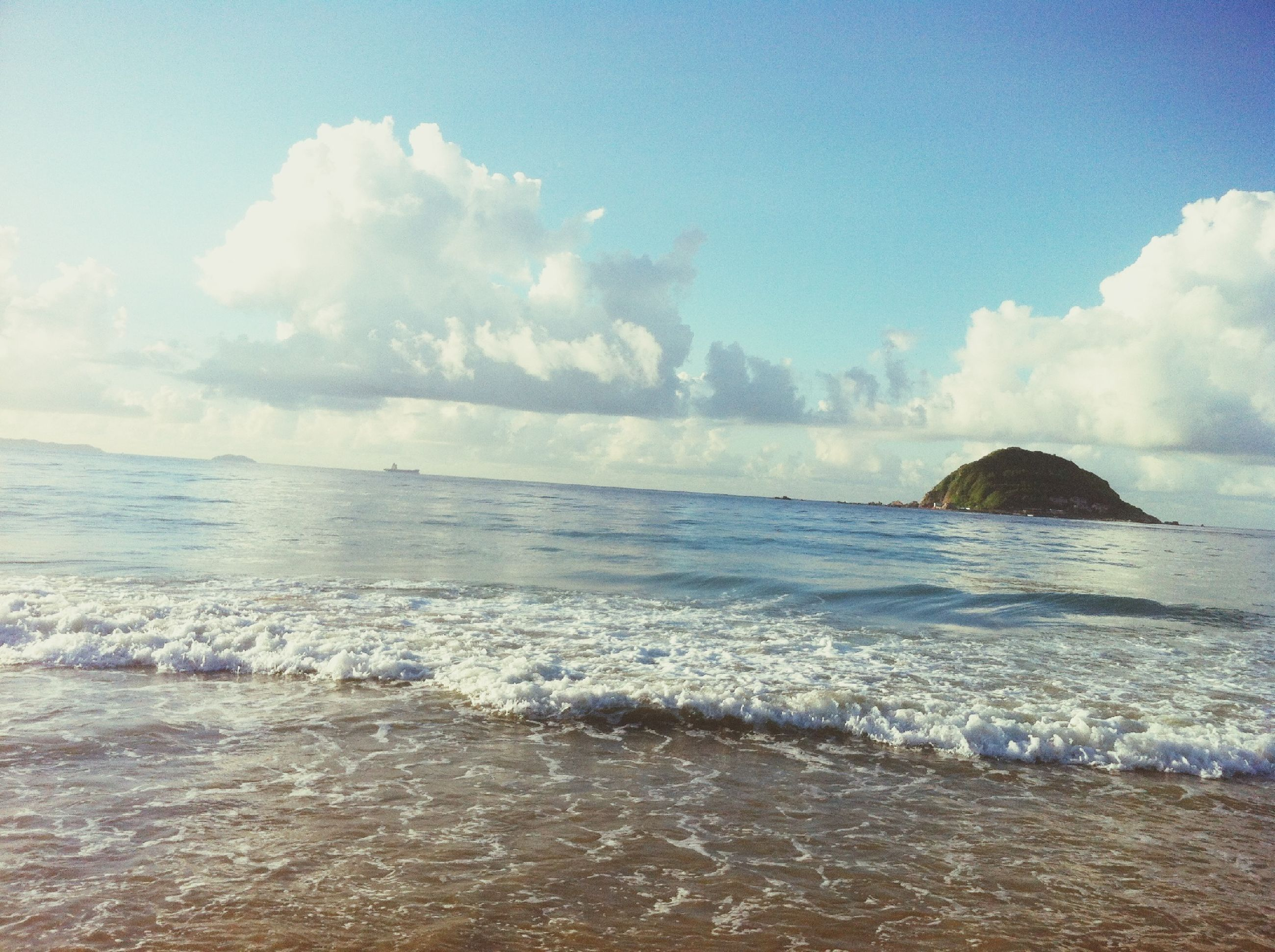 sea, water, sky, beach, scenics, horizon over water, wave, beauty in nature, tranquil scene, shore, surf, cloud - sky, tranquility, nature, idyllic, cloud, rock - object, cloudy, sand, motion