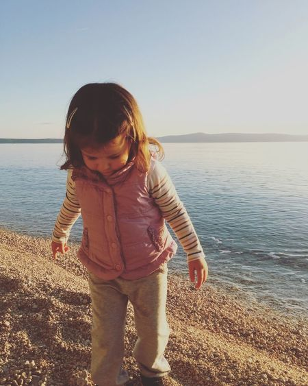 Cute little girl playing on the beach Adorable Beach Beauty In Nature Casual Clothing Caucasian Child Childhood Children Clear Sky Croatia Cute Horizon Over Water Kid Leisure Leisure Activity Lifestyles Little Outdoors Pebble Play Sea Shore Small Toddler
