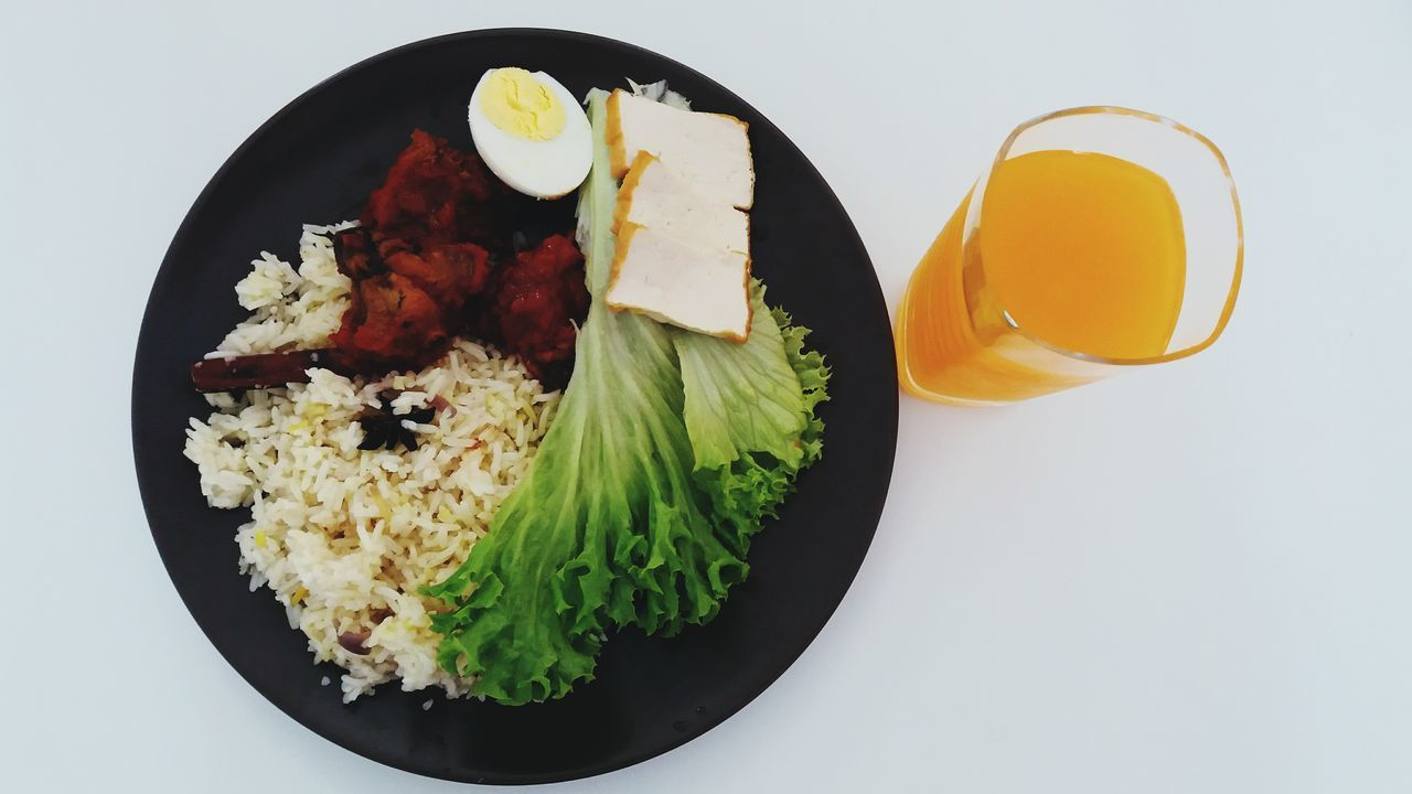 Food And Drink White Background Indoors  Healthy Eating Close-up Freshness Nasi Minyak Fresh Orange Juice Ready-to-eat