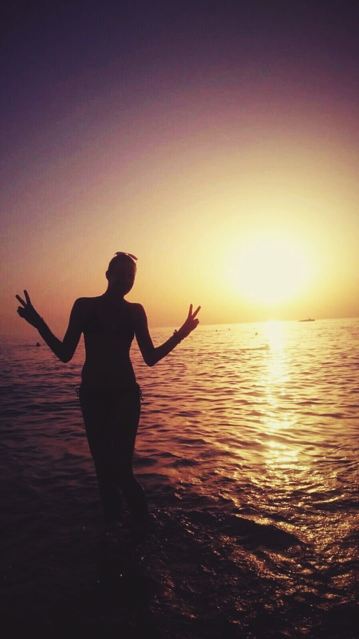 sunset, sea, silhouette, water, full length, standing, real people, one person, scenics, beauty in nature, tranquil scene, horizon over water, nature, beach, lifestyles, leisure activity, outdoors, vacations, men, sky, day, people
