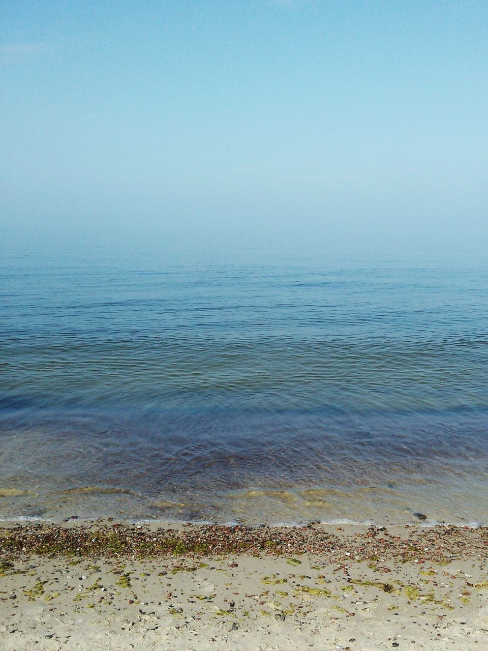 Scenic View Of Sea Against Clear Sky In Foggy Weather