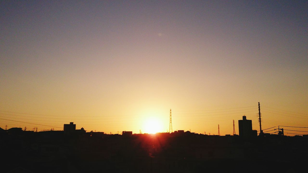 sunset, silhouette, sun, built structure, architecture, building exterior, sunlight, sky, no people, outdoors, nature, city, factory, skyscraper, cityscape, clear sky, beauty in nature, water tower - storage tank, tree, day