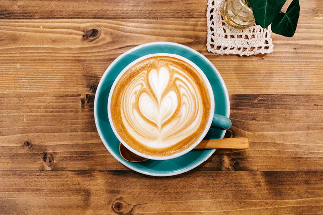 Coffee on table with plant Coffee Coffee Cup Cup Directly Above Drink Indoors  Latte Plant Refreshment Saucer Spoon Table