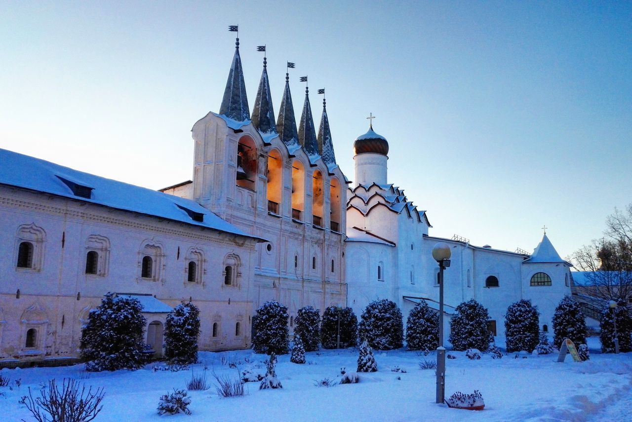 architecture, building exterior, built structure, place of worship, outdoors, religion, low angle view, no people, spirituality, day, clear sky, snow, cold temperature, nature, sky