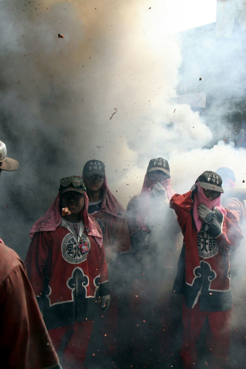 real people, smoke - physical structure, men, religion, outdoors, togetherness, lifestyles, day, large group of people, sky, people