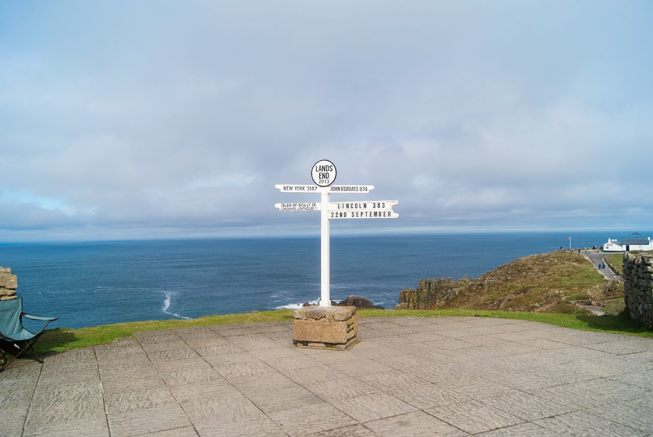Lands End Sea Cloud - Sky Outdoors No People Sky Horizon Over Water Water Landscape Day Blue Signs Signboard Sign