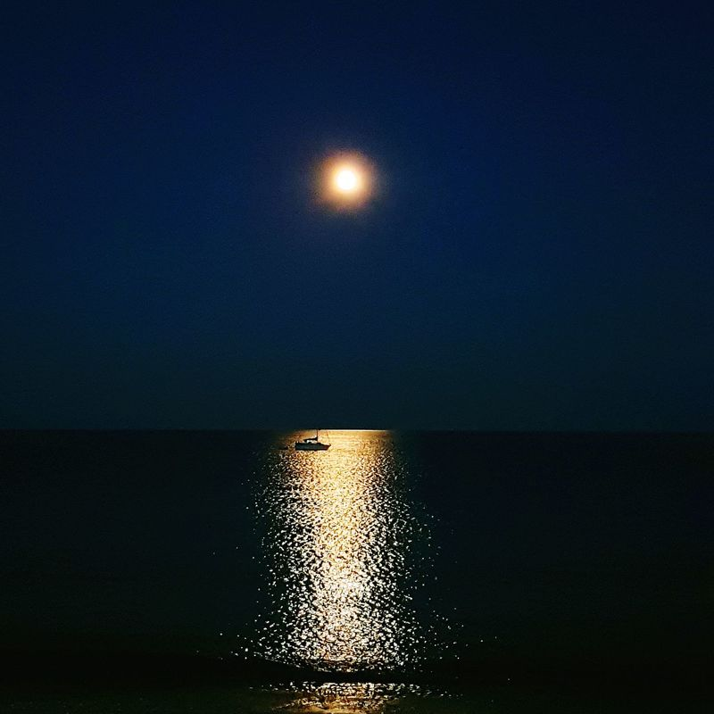 Moon Night Sea Water Beach Reflection Sky Outdoors No People Horizon Over Water Tranquility Nature Star - Space Illuminated Scenics Beauty In Nature Astronomy Space Boats⛵️ Silhouette Reflection Sea Moonlight Moonphotography The Week On EyeEm
