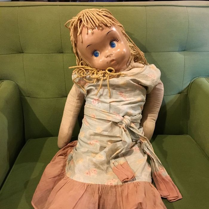 Old Doll Childhood Indoors  Cute Innocence Person Girls Waist Up Three Quarter Length Lifestyles Casual Clothing Holding Towel Baby Clothing Toddler  Human Face Vintage Doll Vintage Doll Creepy Doll Mid Century Green Chair Toy Furniture Thrift Shop
