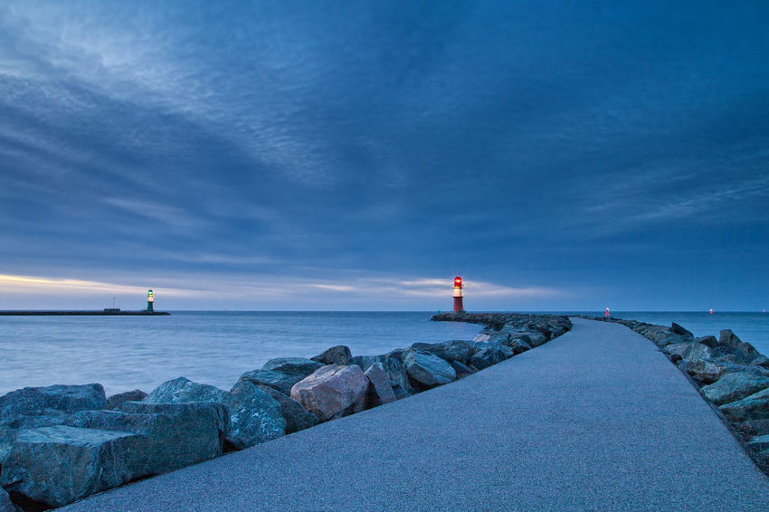 Mole in Warnemuende, Germany. Architecture Beach Beauty In Nature Building Exterior Built Structure Cloud - Sky Coastline Day Evening Horizon Over Water Landmark Lighthouse Lighthouse Mole Nature No People Outdoors Rostock Sea Sky Warnemünde Water