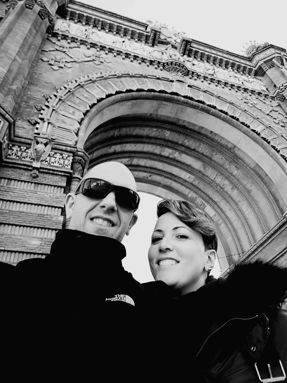 Portrait Of Couple Standing Against Arc De Triomf