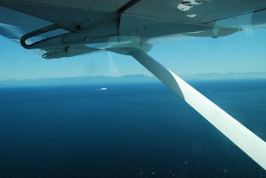 BC Ferries Sea Plane Air Vehicle Airplane Airplane Wing Beauty In Nature Day Horizon Over Water In Flight Mode Of Transport Nature No People Outdoors Scenics Sea Sky Tranquil Scene Transportation Water