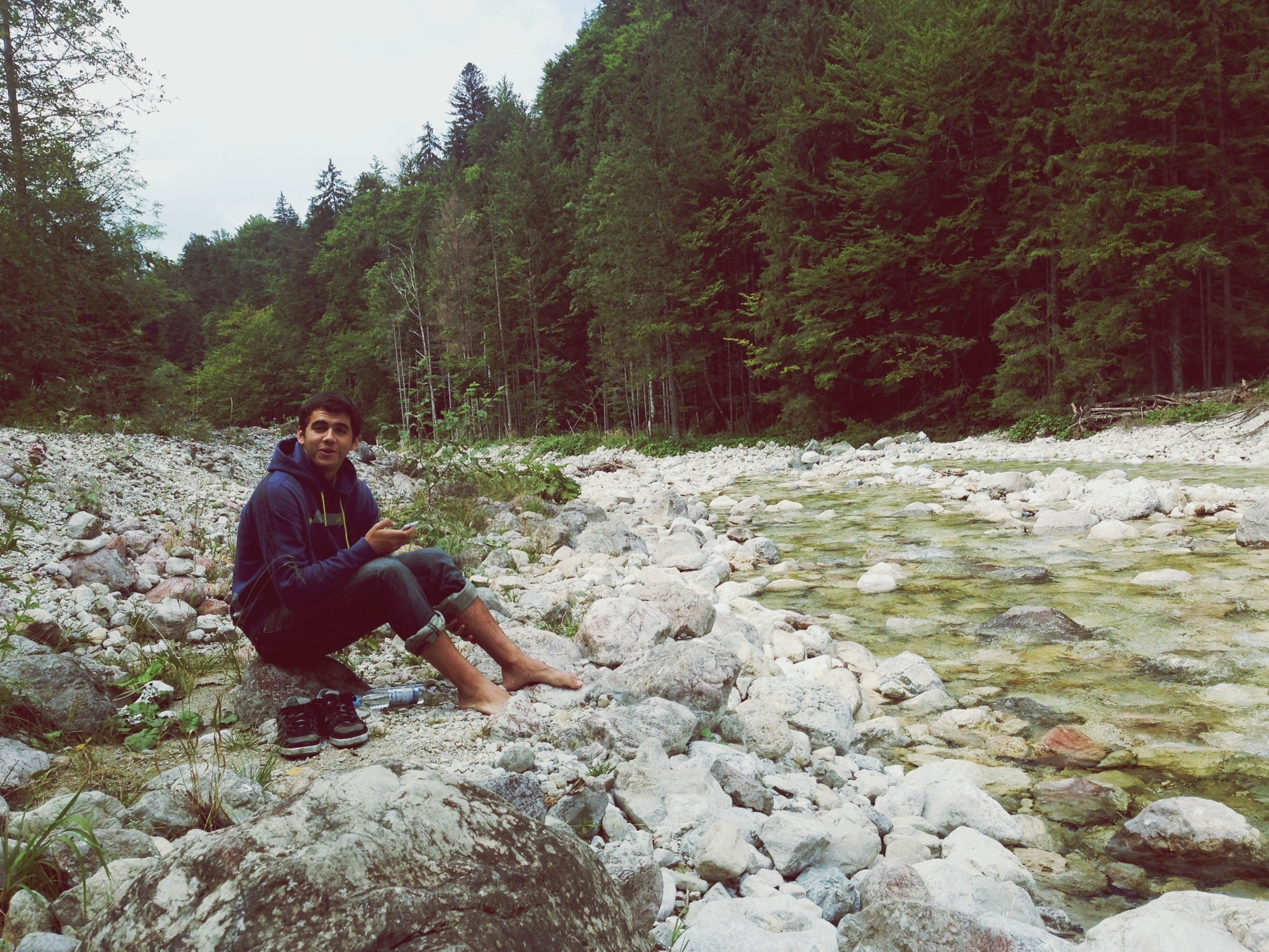 lifestyles, leisure activity, rock - object, casual clothing, full length, young adult, person, tree, standing, sitting, nature, young men, three quarter length, portrait, tranquility, looking at camera, rock