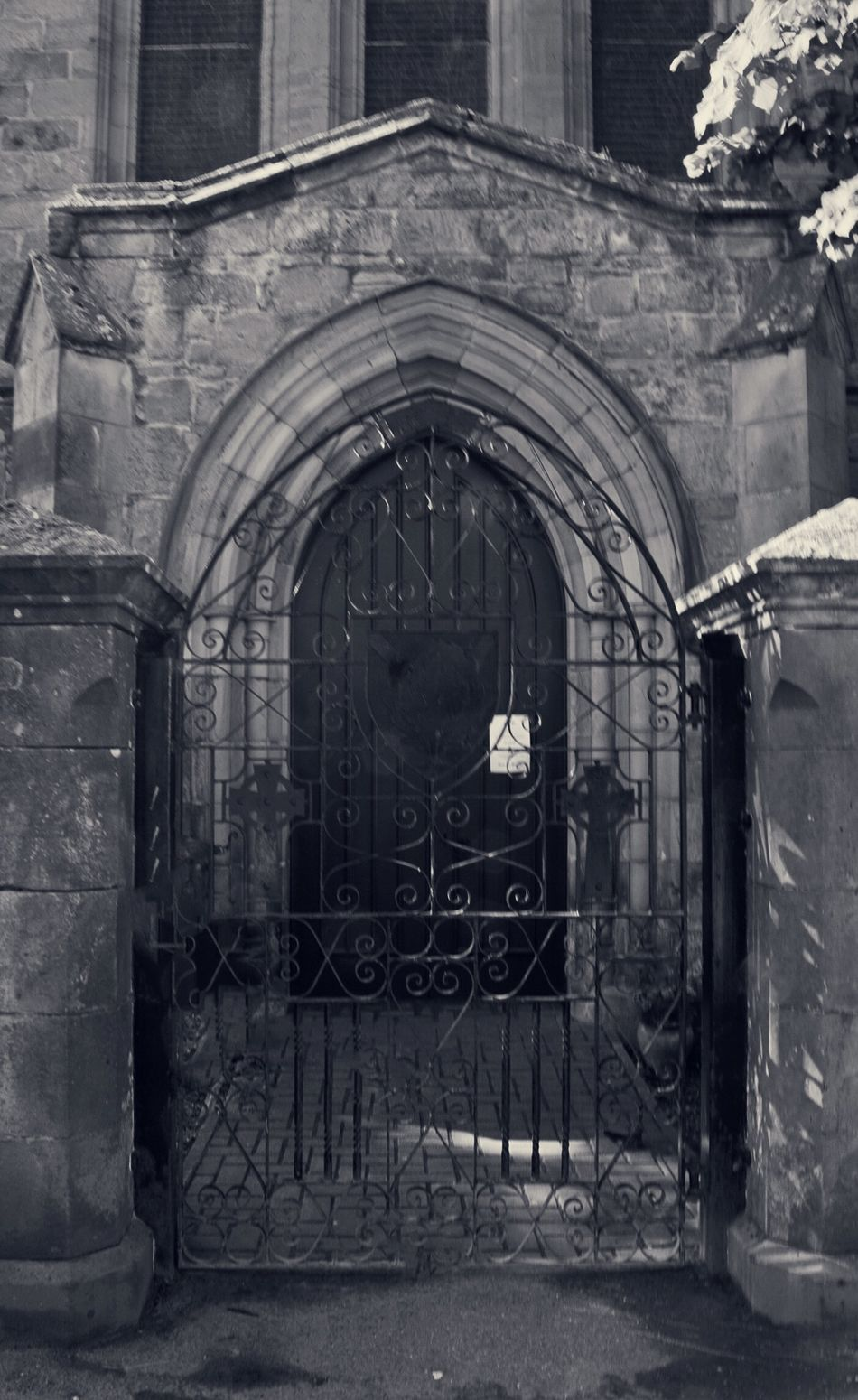 The side door of the Dornoch Cathedral, Dornoch, Scotland. On tour with @rabbies_tours Rabbie's Tours Arched Wooden Door Iron Gates Dornoch Scotland Cathedrals  Scottish North