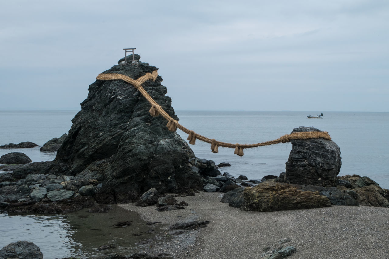 Meoto Iwa, Futami Shrine. The rocks represent Izanagi and Izanami, the creators of kami, and celebrate the union in marriage Izanagi Izanami Japan Meoto Iwa Rock - Object Sea Shinto Shore Shrine Water