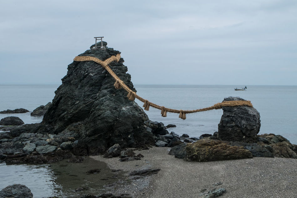 Meoto Iwa, Futami Shrine. The rocks represent Izanagi and Izanami, the creators of kami, and celebrate the union in marriage Izanagi Izanami Japan Meoto Iwa Rock - Object Sea Shinto Shore Shrine Water