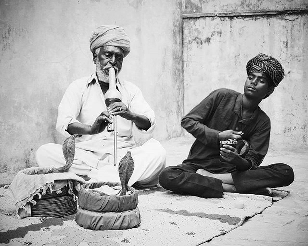 two people, music, sitting, musical instrument, musician, mature adult, adult, only men, men, mature men, arts culture and entertainment, full length, adults only, performance, outdoors, playing, people, day, real people, young adult, saxophone