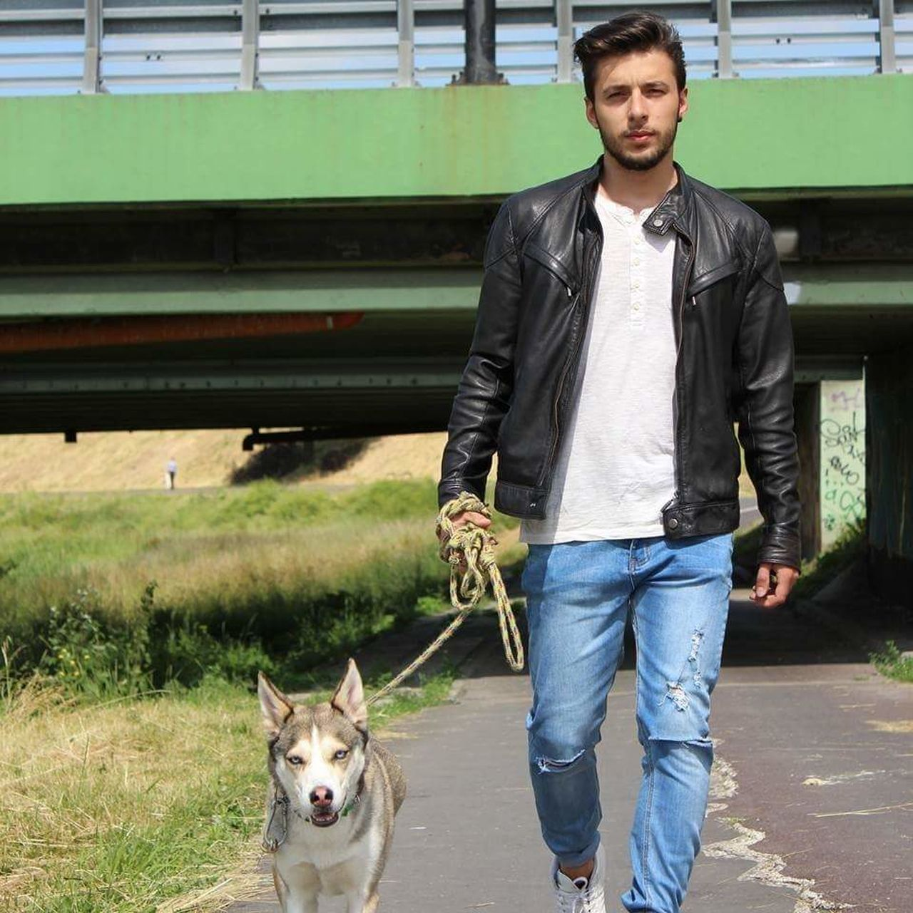 Transportation Standing One Animal Mammal Casual Clothing Person Domestic Animals Mode Of Transport Travel Young Adult Full Length Lifestyles Leisure Activity Front View Pet Owner Pets Railroad Station Platform Outdoors