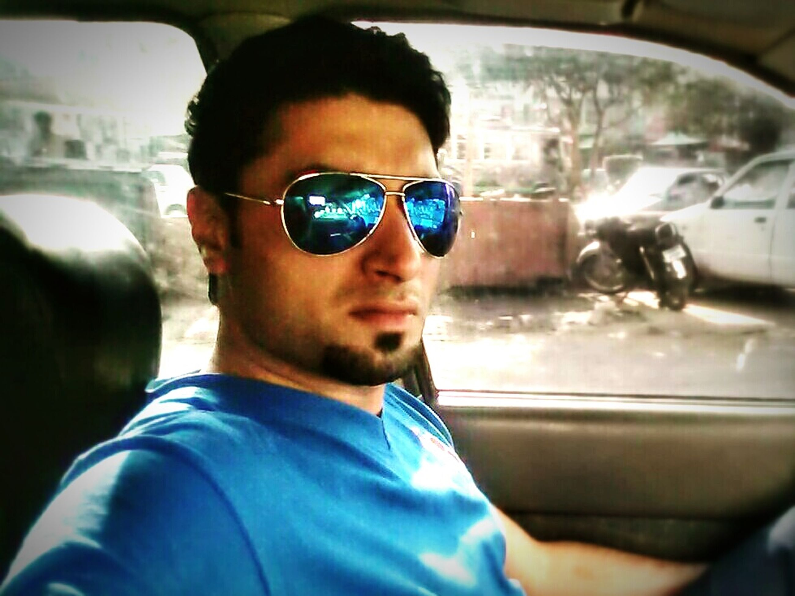 lifestyles, transportation, car, headshot, mode of transport, person, land vehicle, focus on foreground, close-up, leisure activity, sunglasses, portrait, looking at camera, front view, head and shoulders, young men, vehicle interior, reflection