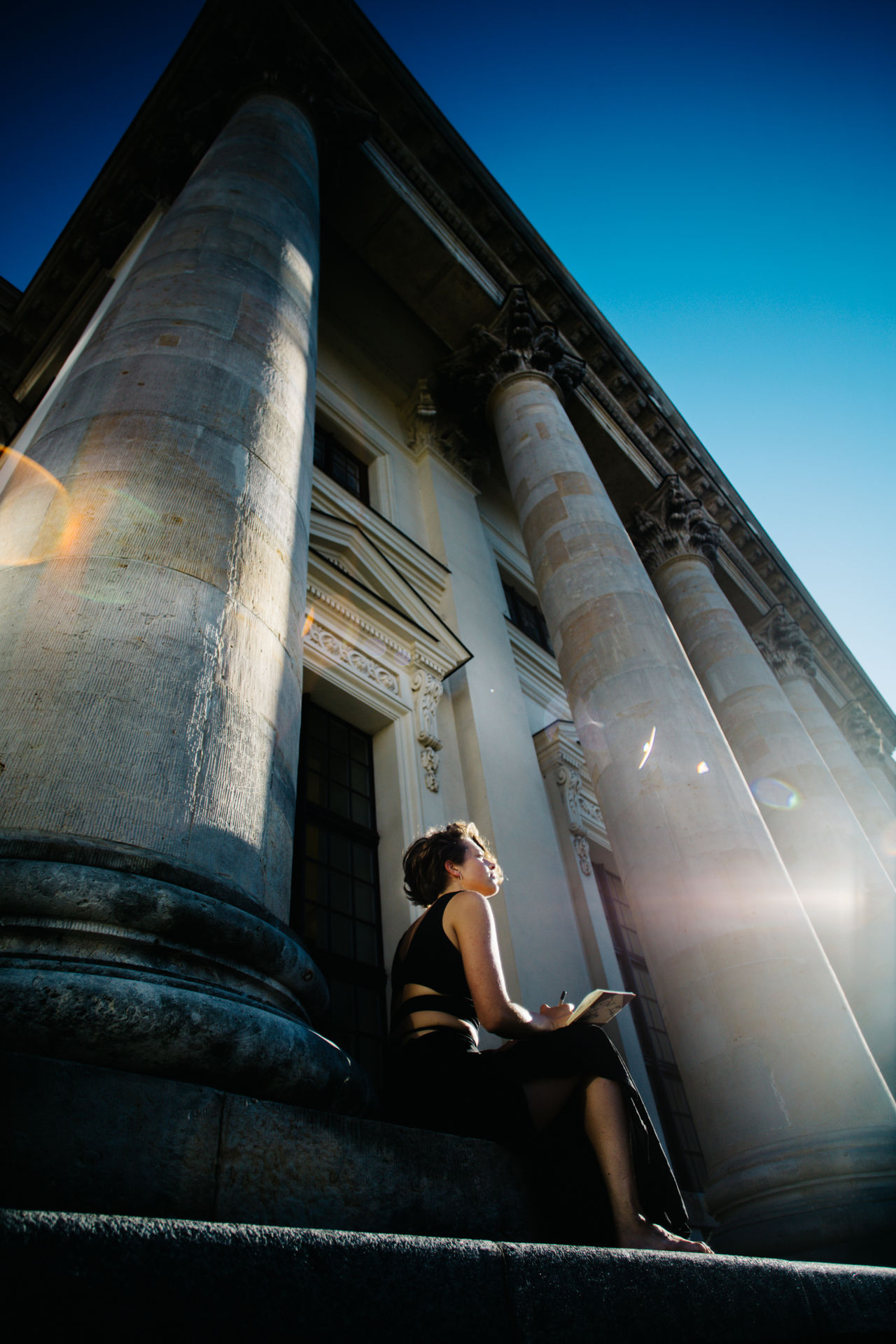 Architectural Column Architecture Beauty In Eye Of Beholder Berlin Berlin Photography Built Structure Day Girl Lifestyles One Person Sky Sunlight The Portraitist - 2017 EyeEm Awards The Street Photographer - 2017 EyeEm Awards Writer Young Young Adult Young Women