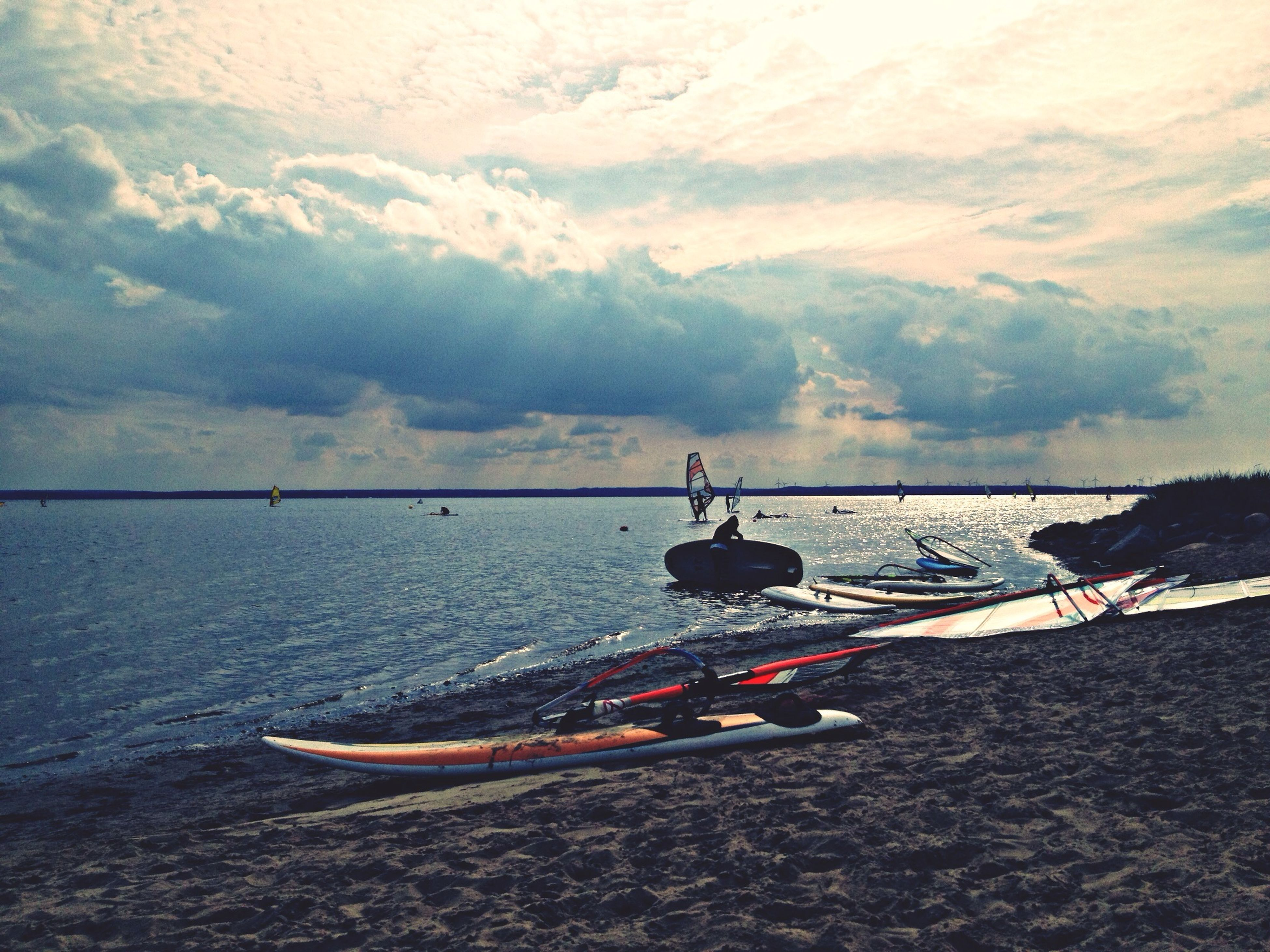 water, nautical vessel, transportation, boat, mode of transport, sea, sky, tranquil scene, tranquility, scenics, beauty in nature, moored, nature, cloud - sky, beach, shore, travel, mountain, cloud, sand