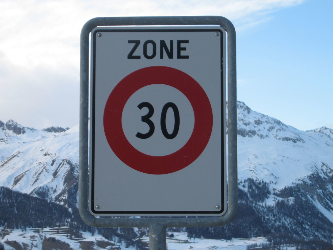 Close-Up Of Road Sign On Snow Covered Mountain