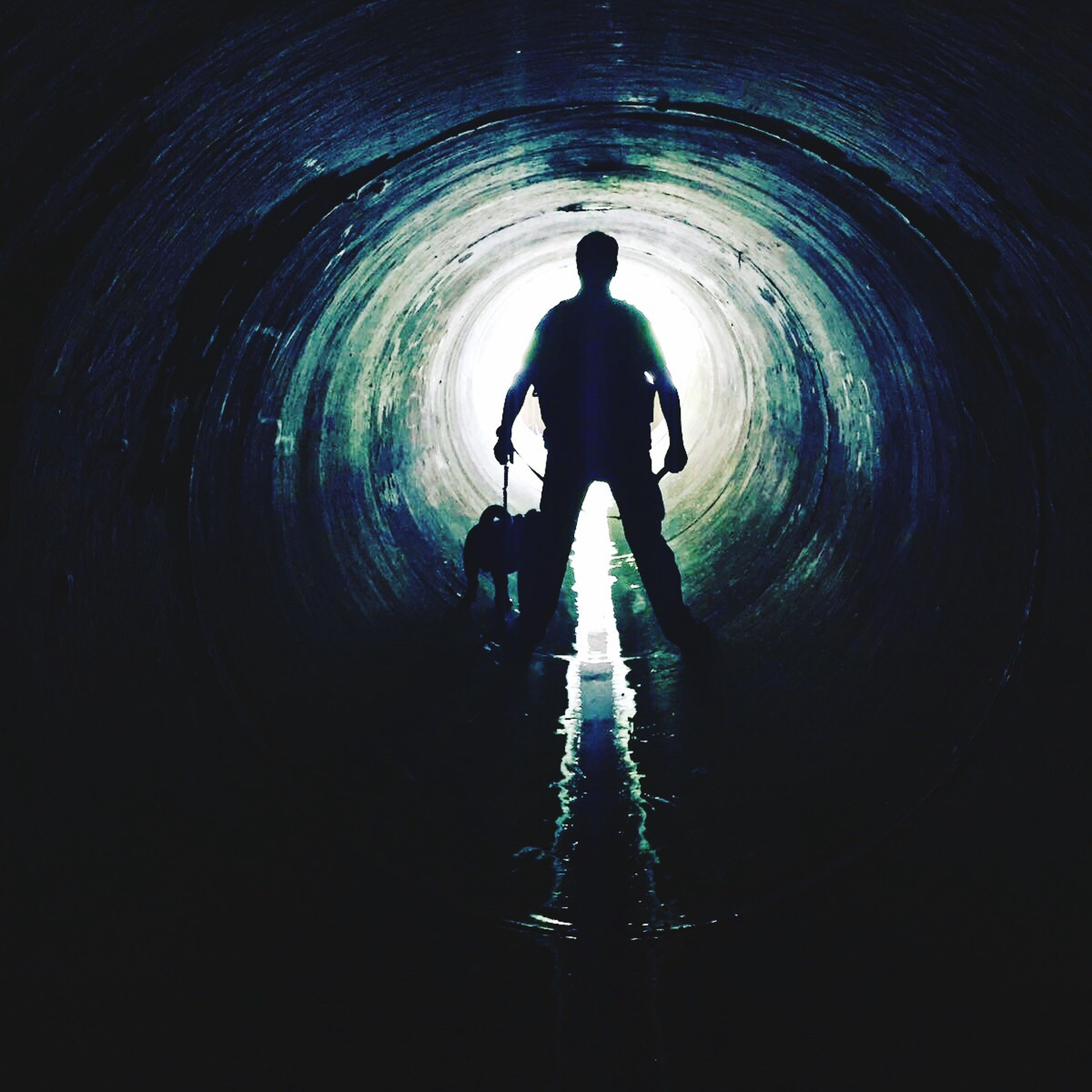 silhouette, lifestyles, men, tunnel, full length, walking, indoors, leisure activity, rear view, togetherness, boys, bonding, standing, holding hands, childhood, dark