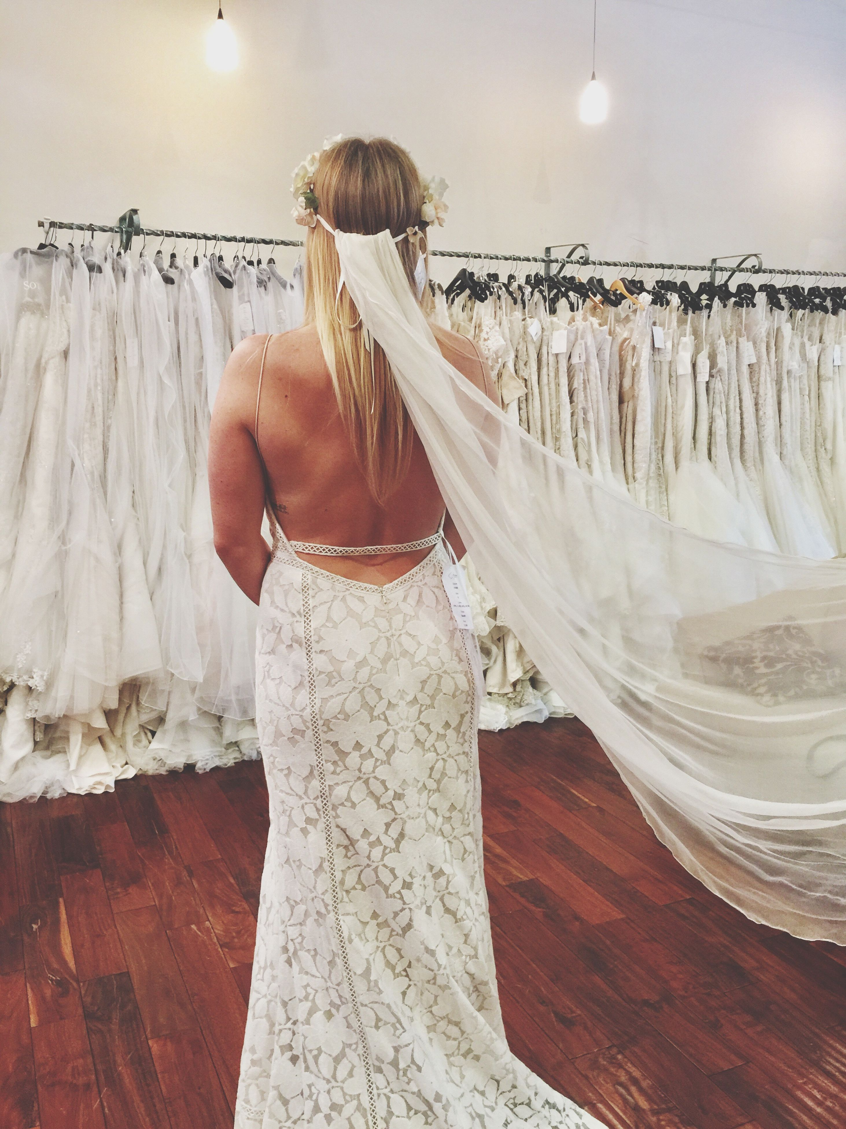 only women, one woman only, fashion, one person, rear view, adults only, business finance and industry, clothing store, indoors, people, one young woman only, wedding dress, adult, bridal shop, day