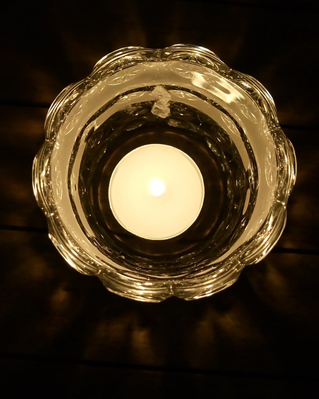 illuminated, lighting equipment, candle, tea light, glowing, no people, indoors, flame, close-up, light bulb, night, electricity, black background