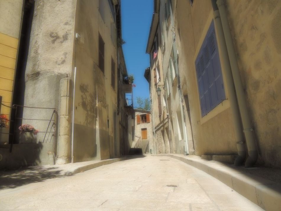 Alley Architecture Building Exterior Built Structure City Life Day Diminishing Perspective Footpath Long Narrow No People Provence Residential Building Residential District Sky Softlight Photography Surface Level Tall The Way Forward Tranquil Scene Tranquility Vanishing Point