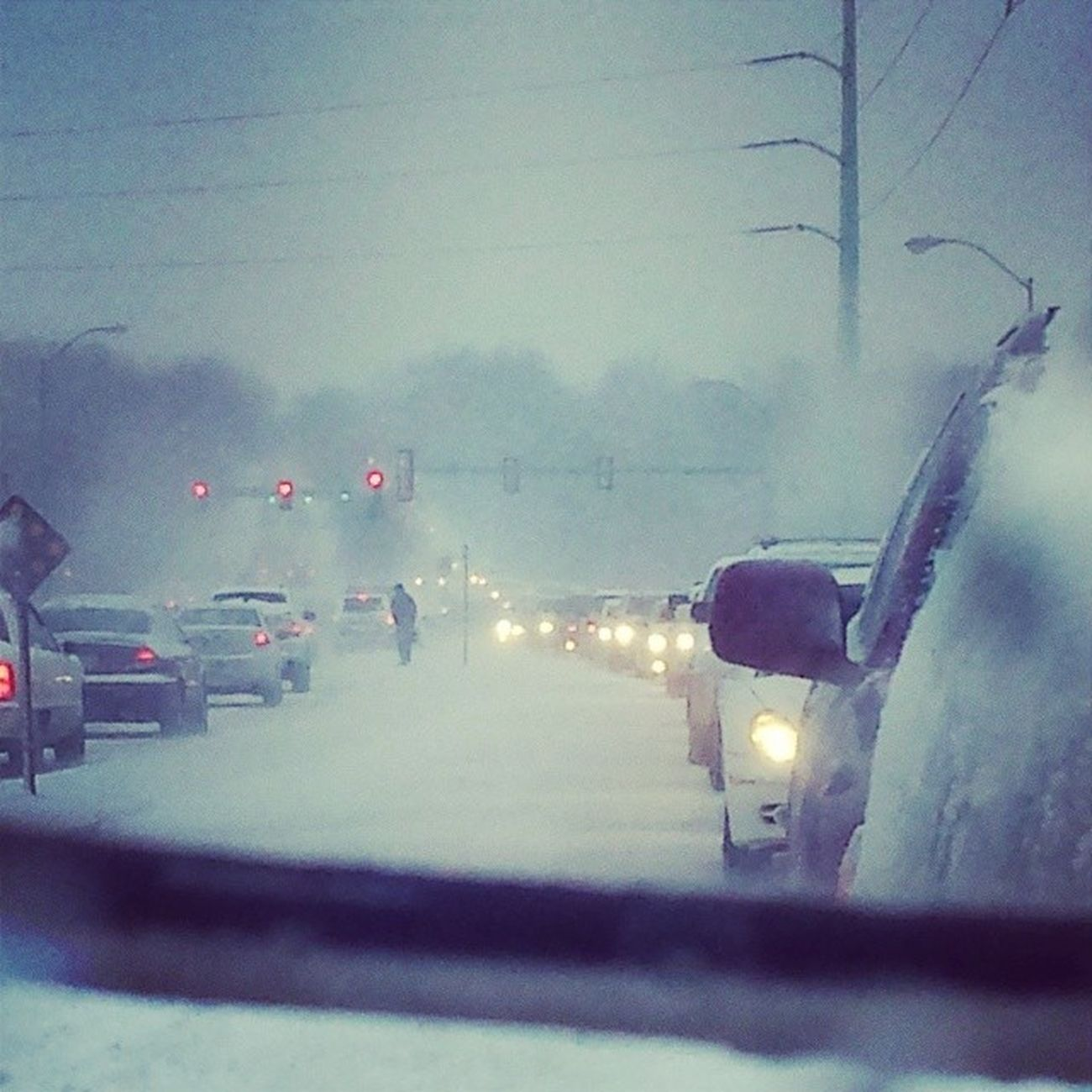 """My rearview while """"parked"""" on my drive home this afternoon. A 15 minute drive took an hour! Surpriseblizzard"""