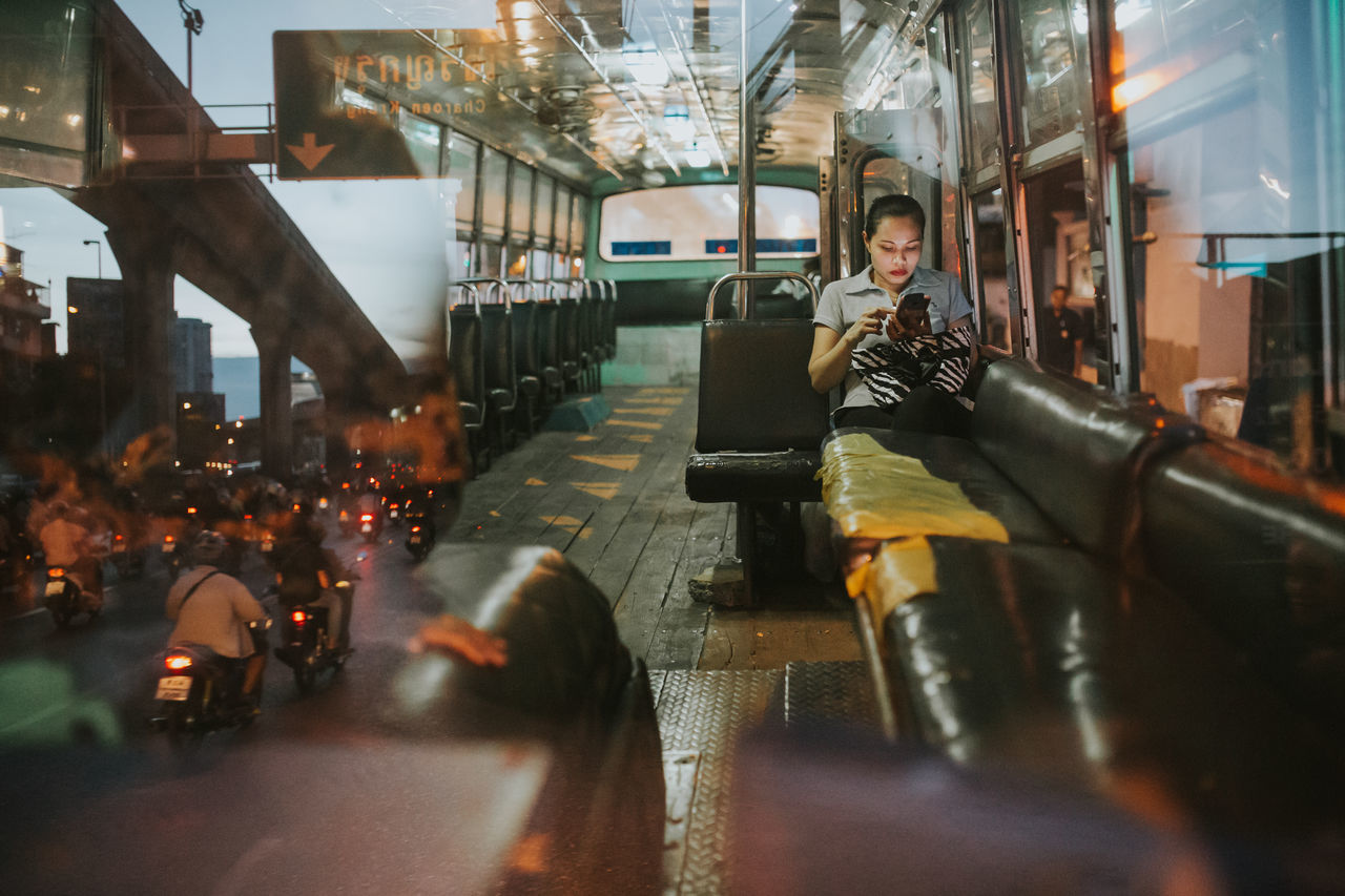 By Bangkok Bus Bangkok Bus Commute Editorial  Lifestyles Live For The Story One Person People Real People Reflection Sitting Social The Street Photographer - 2017 EyeEm Awards By Bangkok Bus Transportation Young Women