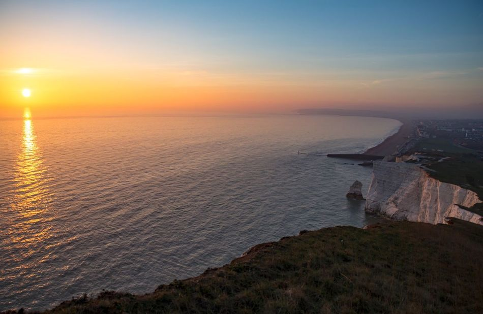 Sunset By The Cliffs Sundown Sun Seaside Cliffs Sea Sunset Horizon Over Water Beauty In Nature Scenics Tranquility Water No People Admiring The View Calmness Landscape Sunset_collection Waiting To Set Idyllic Outdoors Cliff Edge