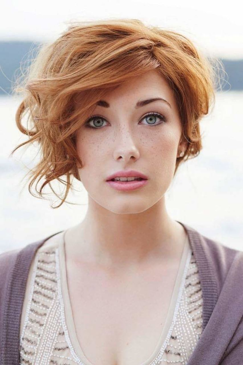 redhead, portrait, looking at camera, one person, front view, beautiful woman, headshot, close-up, young adult, outdoors, day, only women, beauty, young women, one woman only, real people, adult, one young woman only, people, adults only