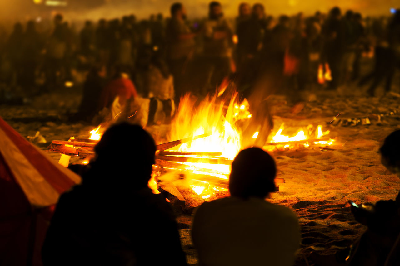 Crowd By Bonfire At Night