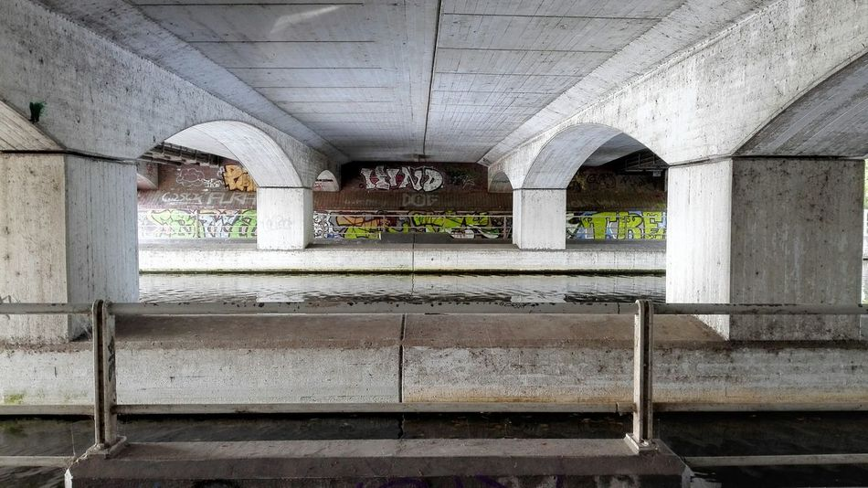 Under the bridge 2 Architecture Built Structure Arch Architectural Column Building Exterior Concrete Day Arched Weathered Balustrade No People Arcade