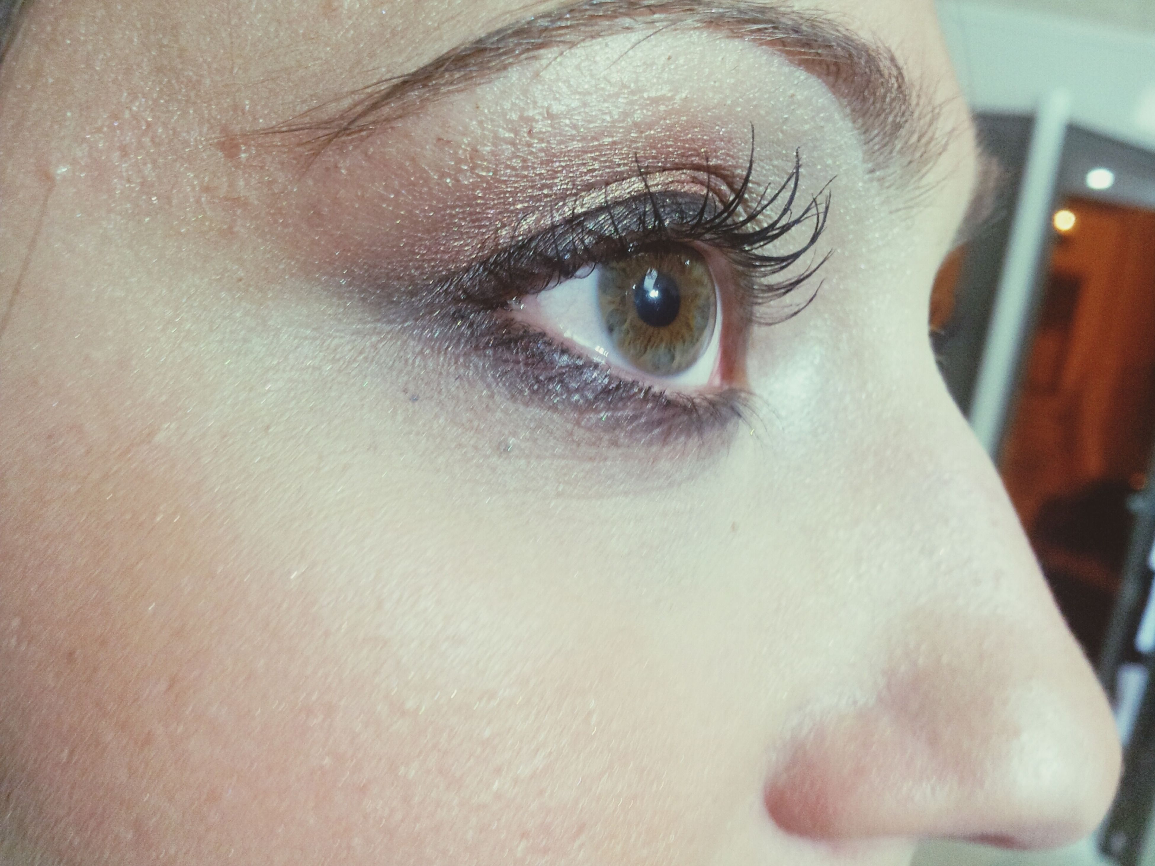 close-up, portrait, looking at camera, indoors, human eye, human face, headshot, lifestyles, young adult, part of, front view, human skin, person, eyelash, eyesight, focus on foreground, leisure activity