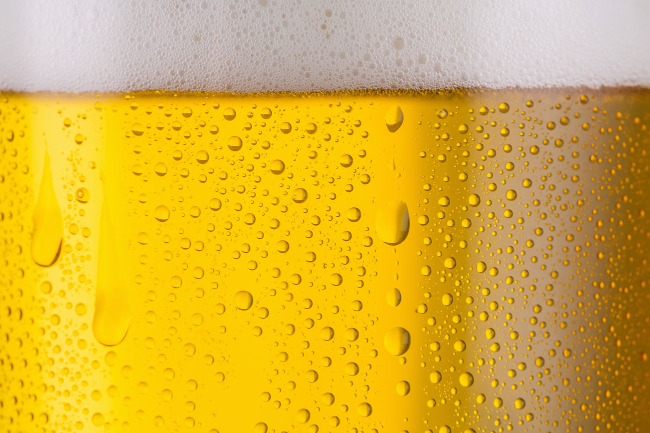 Cold fresh Beer with Drops of Condensation Alcohol Alcoholic Drink Backgrounds Beer - Alcohol Beer Glass Bubble Cold Temperature Condensation Dew Drink Drinking Glass Drop Froth Frothy Drink German Gold Colored Golden Liquid Pint Glass Refreshment Texture Textured  Wet Yellow