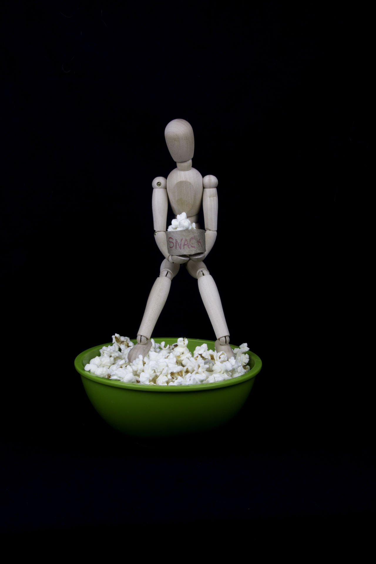 Snacking on popcorn Black Background Bowl Close-up Day Food Food And Drink Freshness Indoors  No People Popcorn Snack Studio Shot