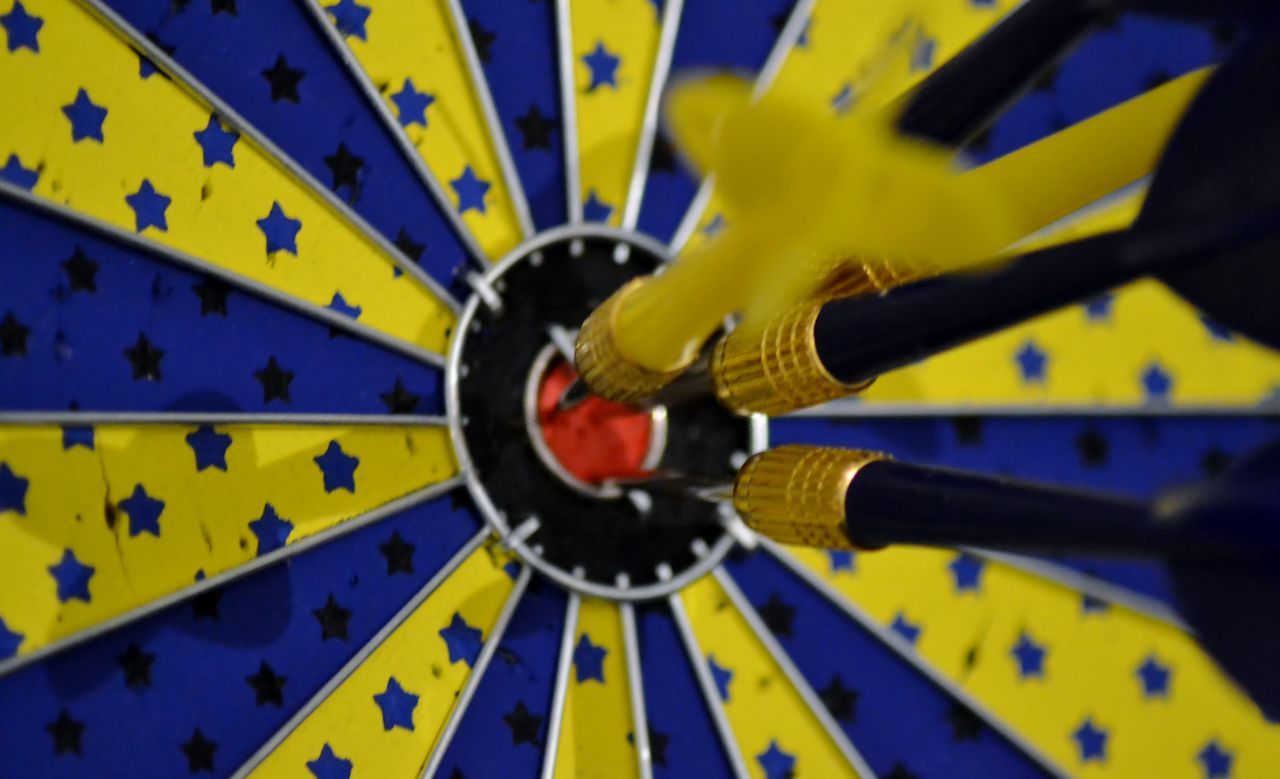 Close-up Of Dartboard With Arrows